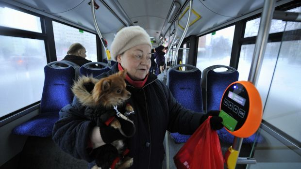 A woman and her dog avail of the free bus service in Tallinn, Estonia. Photograph: Raigo Pajula/AFP/Getty Images