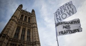 Pro-Brexit flags outside the Houses of Parliament in London. While the UK has repeatedly reiterated its desire not to see a hard border, how to achieve that in a no-deal context is unclear. Photograph: PA