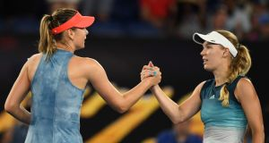 Maria Sharapova of Russia and Caroline Wozniacki of Denmark shaking hands at their  Australian Open match. Photograph: . EPA/Lukas Coch