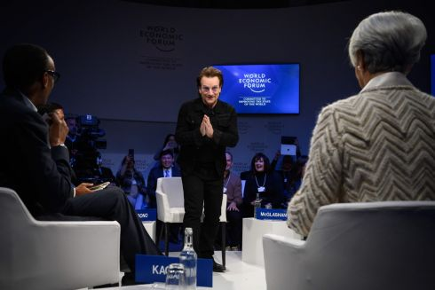 DAVOS: U2 frontman Bono (centre) faces Rwanda's president Paul Kagame (left) and International Monetary Fund (IMF) managing director Christine Lagarde during a session at the World Economic Forum (WEF) annual meeting, on January 23rd in Davos, Switzerland. Photograph: Fabrice Coffrini/AFP/Getty