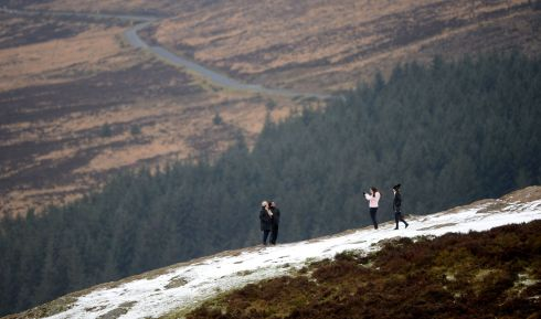 SNOWFALL: People enjoy the view overlooking Luggala in Co Wicklow. A light cover of snow blanketed the Sally Gap, high up in the Wicklow Mountains. Photograph: Alan Betson/The Irish Times