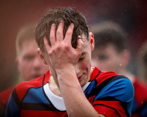 LOSS: Conor O'Shaughnessy of St. Munchins' reacts after his team's defeat to Rockwell College in the Clayton Hotel Munster Schools Senior Cup first round at Irish Independent Park, Co Cork on January 23rd Photograph: Oisin Keniry/Inpho