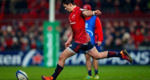 Joey Carbery kicks a penalty in the Heineken Champions Cup Round 6 match between Munster and Exeter Chiefs in  Thomond Park, Limerick, last Saturday. Photograph: Tommy Dickson/Inpho