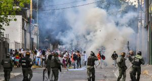 Riot police clash with opposition demonstrators during a protest against the government of President Nicolás Maduro on Wednesday. Photograph: Yuri Cortez/AFP/Getty Images