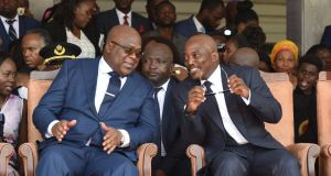 Democratic Republic of Congo's outgoing president Joseph Kabila (right) sits next to his successor Felix Tshisekedi during the inauguration ceremony in Kinshasa, Democratic Republic of Congo. Photograph: Olivia Acland/Reuters