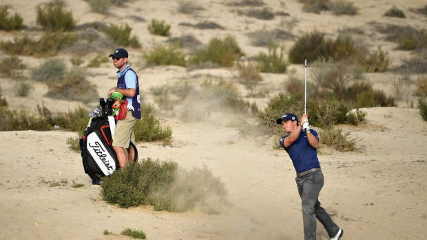 Paul Dunne plays his approach to the eighth from the desert. Photo: Ross Kinnaird/Getty Images