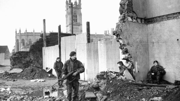 British soldiers patrol the bombed-out ruins of the Broadway Hotel in Newry, Northern Ireland in 1972. Photograph: Terence Spencer/The LIFE Picture Collection/Getty Images.