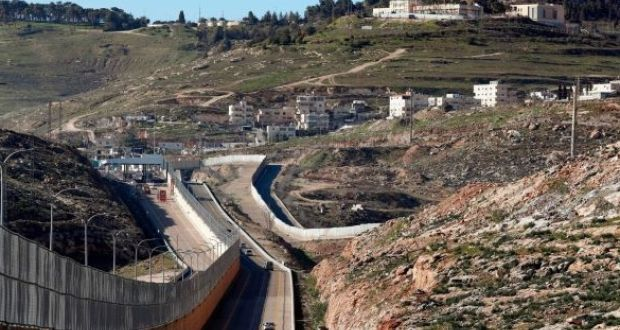 A wall separates Palestinians (right) and the side to be used exclusively by Israelis in a settlement near Jerusalem. Photograph: Getty Images