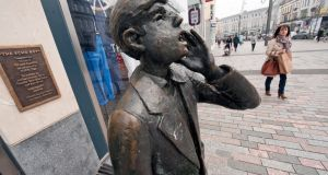 The Echo Boy statue in Cork. The Evening Echo became famous for the group of boys who distributed it on the street. Photograph: Michael Mac Sweeney / Provision