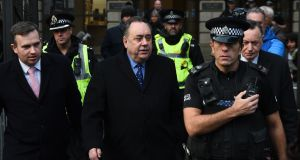Former Scottish first minister  Alex Salmond (centre) leaves court in Edinburgh on Thursday after being charged with two counts of attempted rape and other offences including sexual assault. Photograph: Andy Buchanan/AFP/Getty Images