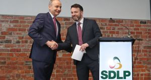Fianna Fáil leader Micheál Martin and SDLP leader Colum Eastwood at the launch of the new partnership in Belfast. Photograph: Niall Carson/PA Wire