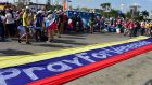 A banner reads 'Pray for Venezuela' as pilgrims wait for the arrival of Pope Francis  in Panama City. Photograph: Johan Ordonez/AFP/Getty Images