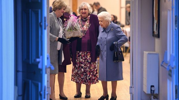 Queen Elizabeth II (R) leaves after attending a Sandringham Women's Institute meeting at West Newton Village Hall, Norfolk. Photograph: Joe Giddens/PA Wire