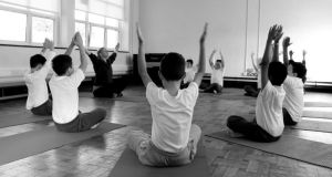 Narrowing the education gap: pupils at Francis Street CBS primary school, in Dublin, in a yoga class