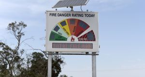 A roadside fire-danger sign signals severe and warns of a total fire ban in Melbourne on Friday. Photograph:  Carla Gottgens/Bloomberg