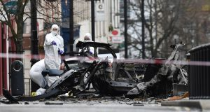 Forensic officers inspect the remains of the vehicle  used as a car bomb outside Derry courthouse on January 20th, 2019. Photograph:  Charles McQuillan/Getty Images