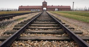 The railway tracks leading to the main gates at Auschwitz II – Birkenau: The more people who study this history the fewer excuses we will have as a society to fall into a similar trap.  Photograph: Scott Barbour/Getty