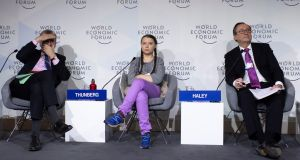 François Villeroy de Galhau, governor of the  central bank of France; 16-year-old Swedish climate activist Greta Thunberg and John J Haley, CEO of Willis Tower Watson, during a panel session in Davos.