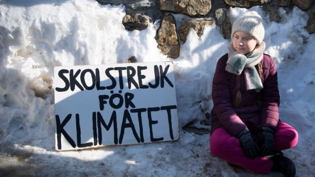 Swedish climate activist Greta Thunberg (16) with a placard reading 'School Strike for Climate', on the last day of the World Economic Forum in Davos, Switzerland. Photograph: Laurent Gillieron/EPA