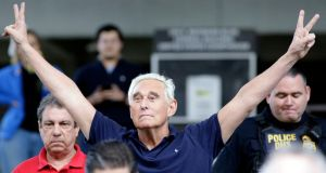 Roger Stone, on leaving the courthouse in Fort Lauderdale, Florida, gestures as Nixon once did.  AP Photo/Lynne Sladky