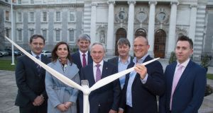 The ESB's Jim Dollard,  Kate Tuohy and Pat O'Doherty;  Minister for the  Environment Richard Bruton; Parkwind's  Francois Van Leeuw and Eric Antoons; and Paul Lennon of the ESB.  Asset Development.