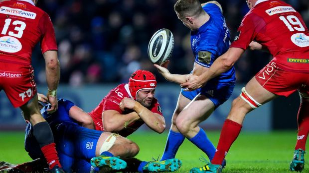 Leinster's Rory O'Loughlin rips the ball off Josh Macleod of Scarlets during the Guinness Pro 14 game at the RDS. Photograph: Tommy Dickson/Inpho