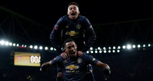 Manchester United's Anthony Martial celebrates with team-mate Jesse Lingard after scoring his side's third goal during the  FA Cup fourth-round game  at Emirates stadium. Photograph: Will Oliver/EPA