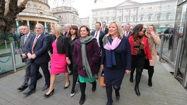 Sinn Fein Leaders Mary Lou McDonald (centre) and Michelle O'Neill (centre right) and their party colleagues leaving Leinster House on their way to the Mansion House Dublin for the centenary commemoration taking place to mark the inaugural public meeting of Dáil Eireann in 1919. Photograph: Niall Carson/PA Wire