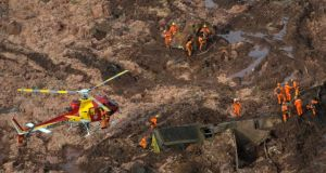 A rescue crew works through the aftermath of the dam burst in Brumadinho, Brazil on January 25th Photograph:  Washington Alves/Reuters