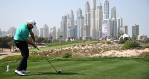 Shane Lowry of Ireland takes his tee shot on hole eight during day three of the Omega Dubai Desert Classic at Emirates Golf Club. Photo: Ross Kinnaird/Getty Images