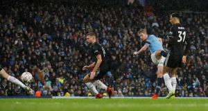 Manchester City's Kevin De Bruyne scores their third goal during the FA Cup fourth-round game against Burnley at the Etihad stadium. Photograph: Phil Noble/Reuters