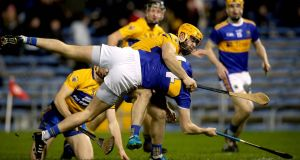 Tipperary's Séamus Callanan is fouled by Jason McCarthy of Clare to win a penalty during the Allianz Hurling League Division 1A match at  Semple Stadium. Photograph: Ryan Byrne/Inpho