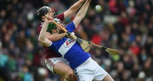 Galway's Ronan Burke challenges Laois's Neil Foyle. Photograph: Tommy Grealy/Inpho