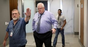 A member of security gestures to the photographer as former Bosasa chief operations officer, Angelo Agrizzi arrives at the Judicial Commission of Inquiry, probing state capture in Johannesburg, South Africa on January 21st Photograph: Siphiwe Sibeko/Reuters