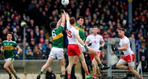 Kerry's Paul Murphy and Jack Barry challenge Tyrone's Cathal McShane in the air. Photograph: Ryan Byrne/Inpho