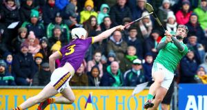 Limerick's Peter Casey shoots under pressure from Liam Ryan of Wexford during the Allianz Hurling League Division 1A match at Innovate Wexford Park. Photograph: Ken Sutton/Inpho