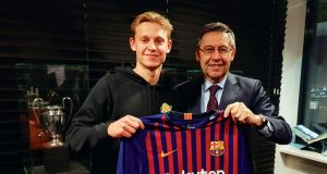 FC Barcelona president Josep Maria Bartomeu  with Dutch player Frenkie de Jong,  in Amsterdam last week. Barcelona has announced signing the Ajax midfielder for €75 million plus a possible €11 million in add-ons. Photograph:  EPA