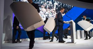 Workers carry podiums off stage, with Borge Brende, World Economic Forum president, prior the closing plenary session in the Congress Hall at the 49th annual meeting of the forum in Davos, Switzerland. Photograph: Gian Ehrenzeller/EPA
