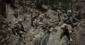 American soldiers from the 101st Airborne Division walkin in the mountains of Paktia Province in Afghanistan, in April 2013. Photograph: Sergey Ponomarev/The New York Times