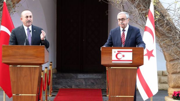 Turkish foreign minister Mevlüt Çavusoglu (L) with president of Northern Cyprus Mustafa Akinci at a joint press conference in the Turkish Cypriot northern part of the divided city of Nicosia, Cyprus. Photograph: EPA/Andreas Manoli