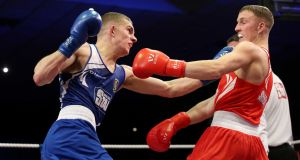 Conor Wallace in action during his amateur days against Michael O'Reilly in the  National Elite Male Championships Finals at the National Stadium, Dublin. Photograph: Ryan Byrne/Inpho