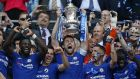 Chelsea's   Gary Cahill lifts the FA Cup as Chelsea players celebrate their win over Manchester United last May. - Chelsea won the game 1-0.  Photograph: Getty Images