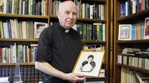 Bishop Daly with a photograph of Jackie Duddy in his office. Photograph: Courtesy of Derry Journal