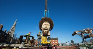 The Luke Kelly statue by Dublin artist Vera Klute is lowered into place on Sherrif Street in Dublin. Photograph:  Paul Kelly