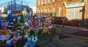 Floral tributes left near at the scene in east Belfast where community worker Ian Ogle was murdered on Sunday night. Photograph: Rebecca Black/PA Wire