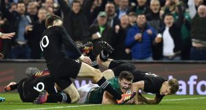 Jacob Stockdale scores a try against New Zealand at the Aviva Stadium in Dublin in November.  Photograph: Charles McQuillan/Getty Images