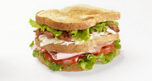 The typical club sandwich consists of toasted white bread layered with cooked poultry,  paired with lettuce, often served with bacon and always slathered in mayo. Photograph: Getty Images