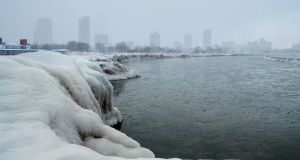 The Chicago city skyline is seen from the North Avenue Beach at Lake Michigan on Tuesday. Photograph: Pinar Istek/Reuters