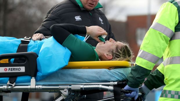 Alison Miller goes off injured after fracturing her fibula and tibia and sustaining a compound ankle fracture minutes in to the Six Nations game against Italy in Donnybrook last February. Photograph: Bryan Keane/Inpho