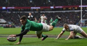 Jacob Stockdale scores his memorable try at Twickenham last season. Photograph:  Shaun Botterill/Getty Images